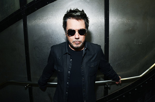 Jean Michel Jarre with a weight of 63 kg and a feet size of N/A in favorite outfit & clothing style
